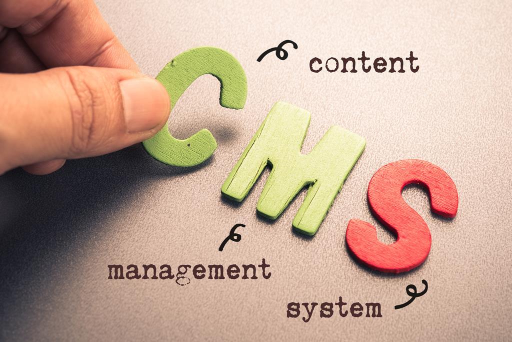 Hand arrange wood letters as CMS (Content Management System)
